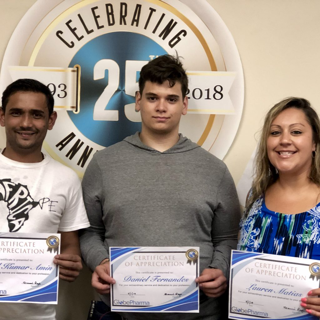 GlobePharma Employees with certificates.